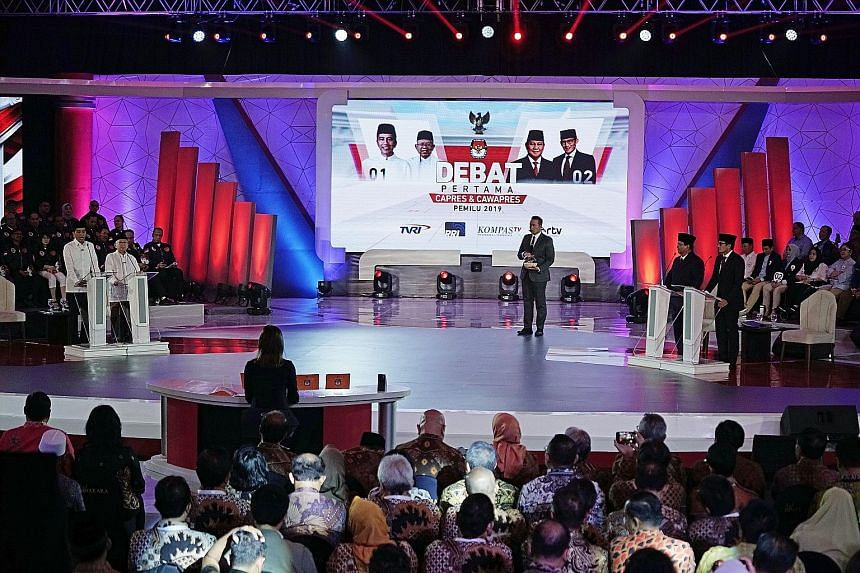 President Joko Widodo speaking during the first presidential debate last Thursday in Jakarta, which was aired live. He and his challenger, Mr Prabowo Subianto, as well as their respective running mates, Dr Ma'ruf Amin and Mr Sandiaga Uno, were provid