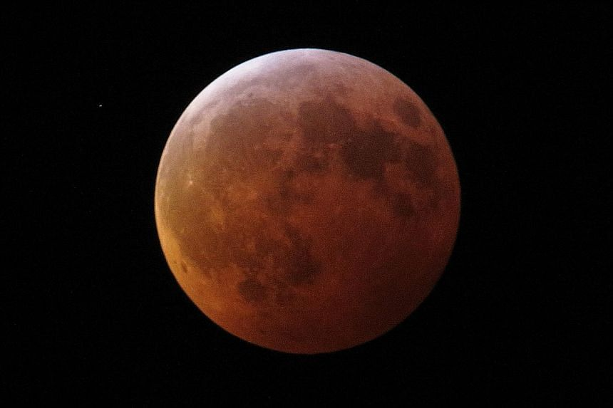 The Super Blood Wolf Moon earned its name because of its reddish-orange glow, and because it appears in January, when wolves would howl in hunger outside villages early in US history, according to The Farmers Almanac.