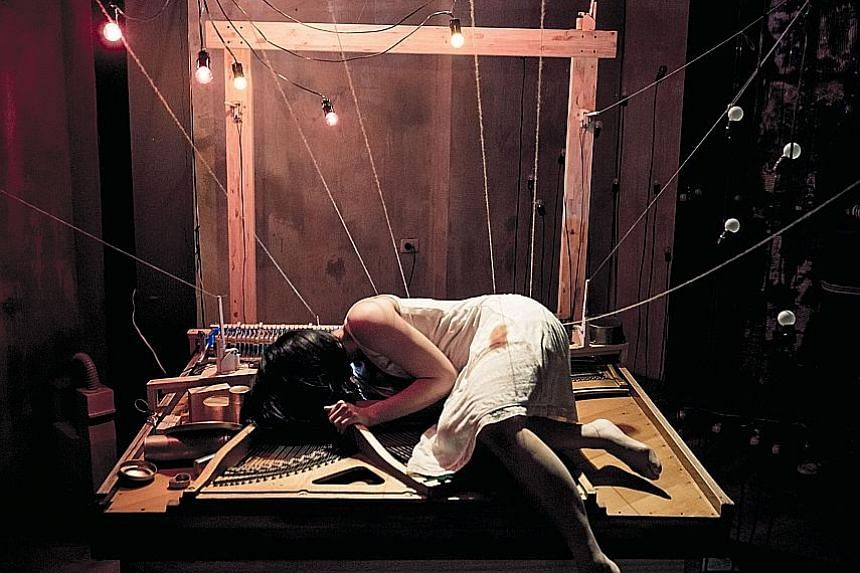 In Taiwanese group M.O.V.E. Theatre's Dear John performance (above), a dancer is bound to a deconstructed piano.