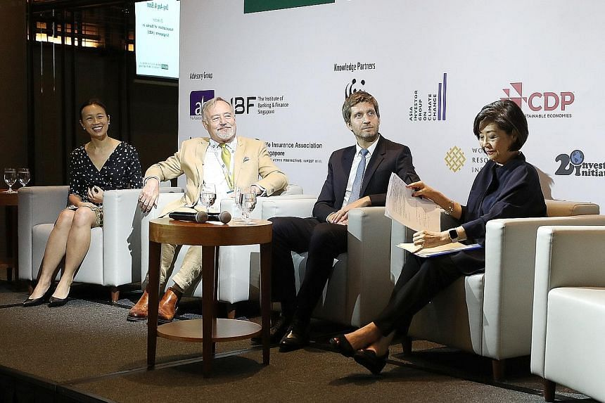 From left: Ms Lydia Wee, deputy chief executive of the Institute of Banking and Finance Singapore; Mr Nicholas Hadow, chairman of the Investment Management Association of Singapore; Mr Pierre-Emmanuel Brard, chief investment officer of AXA Insurance