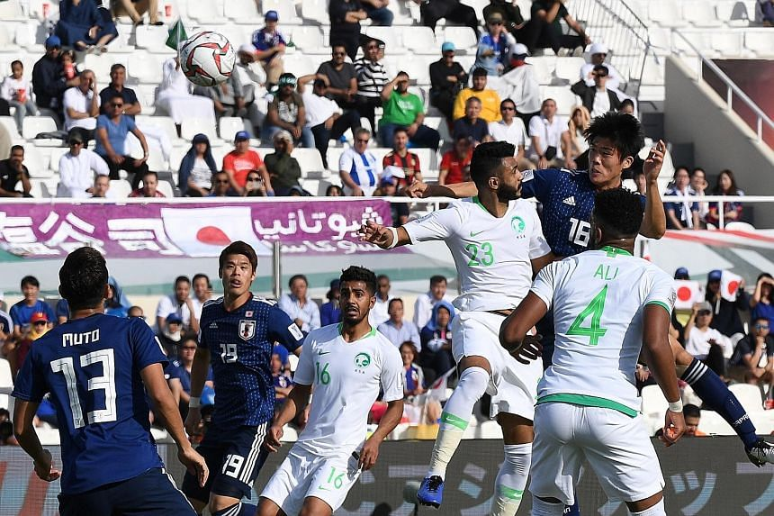 Takehiro Tomiyasu (No. 16) rising highest to head home Japan's winner against Saudi Arabia at the Sharjah Stadium in the United Arab Emirates yesterday. The Samurai Blue will face Vietnam in the quarter-finals on Thursday.