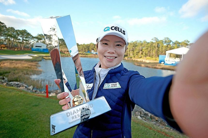 Ji Eun-hee pretending to take a selfie with the trophy after winning the Tournament of Champions on Sunday.