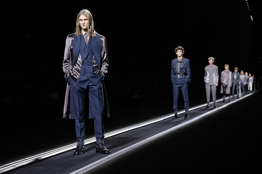 All suited up for the catwalk in Paris: Collections by Dior Homme (above), Dries Van Noten (below left) and Off-White (below right).