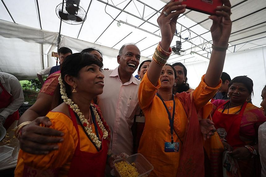 Volunteers taking a wefie with Home Affairs and Law Minister K. Shanmugam. Over the years, steps have been taken to allow music at Thaipusam, he noted. Devotees carrying milk-pot offerings as they walked to Sri Thendayuthapani Temple. This was the fi