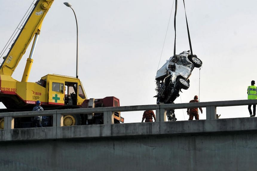 Rescuers retrieving Mr Moey Yun Peng's vehicle three days after it plunged off Penang Bridge and into the sea on Jan 20.