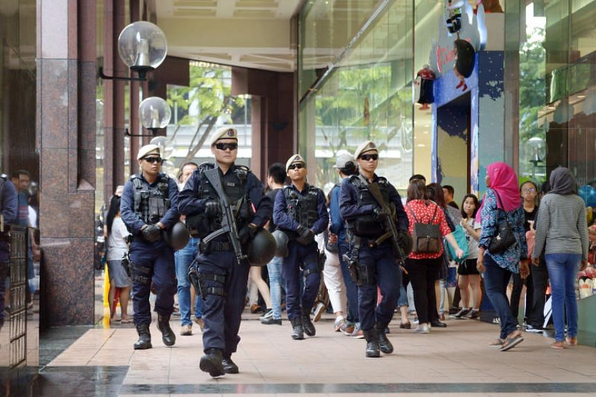 Singapore Police Force's In-situ Reaction Teams from the Protective Security Command patrolling at the Ngee Ann City shopping complex on Orchard Road on Dec 15, 2017.