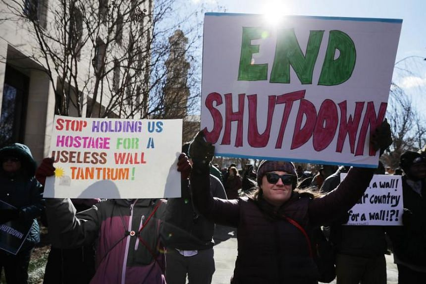 Federal workers and contractors rally against the partial federal government shutdown outside the headquarters of the AFL-CIO in Washington on Jan 10, 2019.