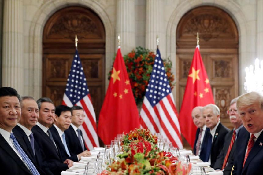 US President Donald Trump, US Secretary of State Mike Pompeo, US national security adviser John Bolton and Chinese President Xi Jinping attend a working dinner after the G-20 leaders summit in Buenos Aires, Argentina, on Dec 1, 2018.