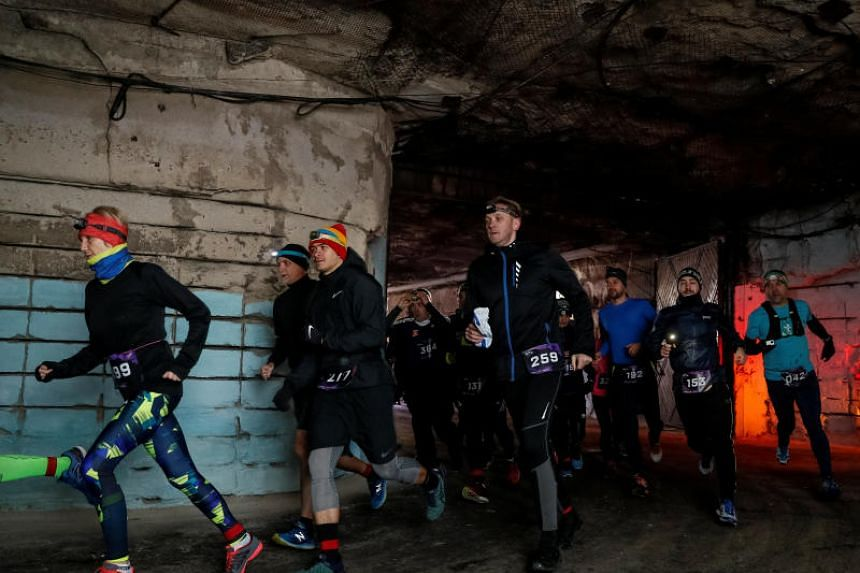 Participants run in the Milestii Mici Wine Run 2019 race, at a distance of 10km in the world's largest wine cellars in Milestii Mici, Moldova, on Jan 20, 2019.