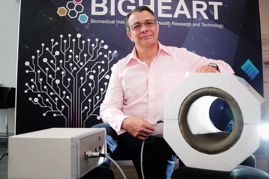 Associate Professor Alfredo Franco-Obregon with the device MRegen, which targets the muscles in a user's leg with a specific magnetic signature and creates metabolic activity in the cells similar to when a person exercises.