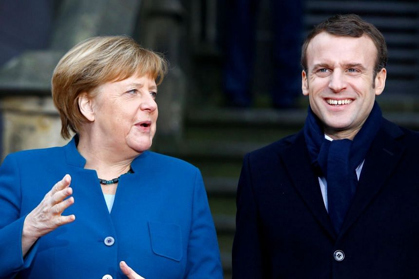 German Chancellor Angela Merkel and French President Emmanuel Macron attend a signing of a new agreement on bilateral cooperation and integration, known as Treaty of Aachen, in Aachen, Germany, on Jan 22, 2019.