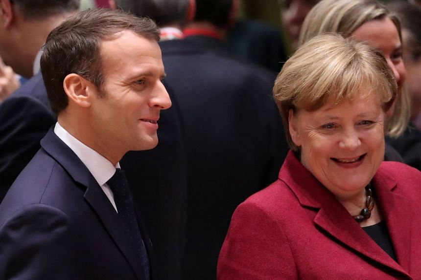 File photo of German Chancellor Angela Merkel and France's President Emmanuel Macron at a European Union leaders' summit in Brussels, Belgium, on Dec 13, 2018.