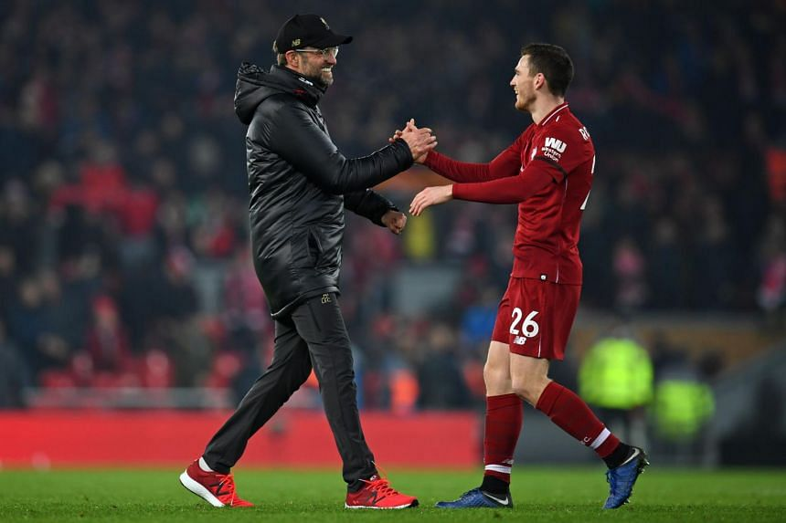 Liverpool's German manager Jurgen Klopp (left) with Liverpool's Scottish defender Andrew Robertson on the pitch after the English Premier League football match between Liverpool and Crystal Palace at Anfield in Liverpool, on Jan 19, 2019.