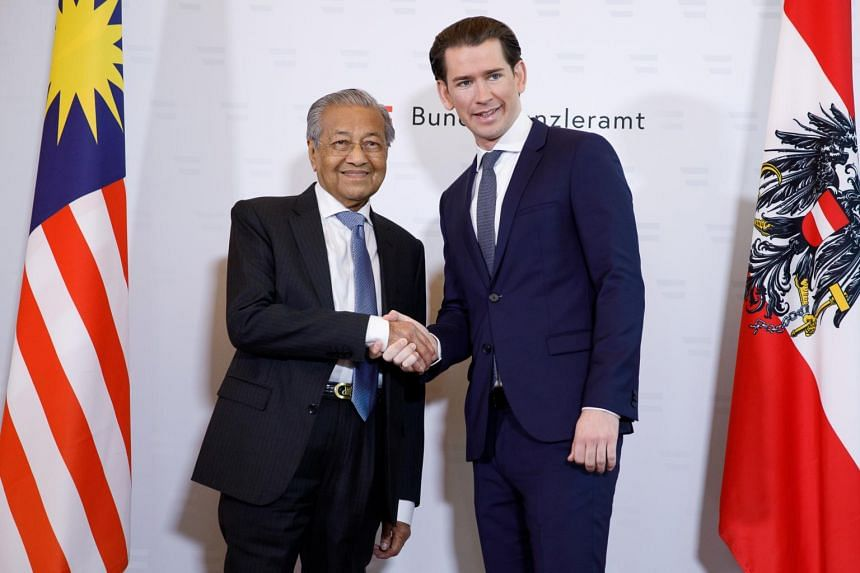 Malaysia's Prime Minister Mahathir Bin Mohamad (left) and Austrian Chancellor Sebastian Kurz shake hands prior to their meeting at the Ferderal Chancellery in Vienna, Austria, on Jan 21, 2019.