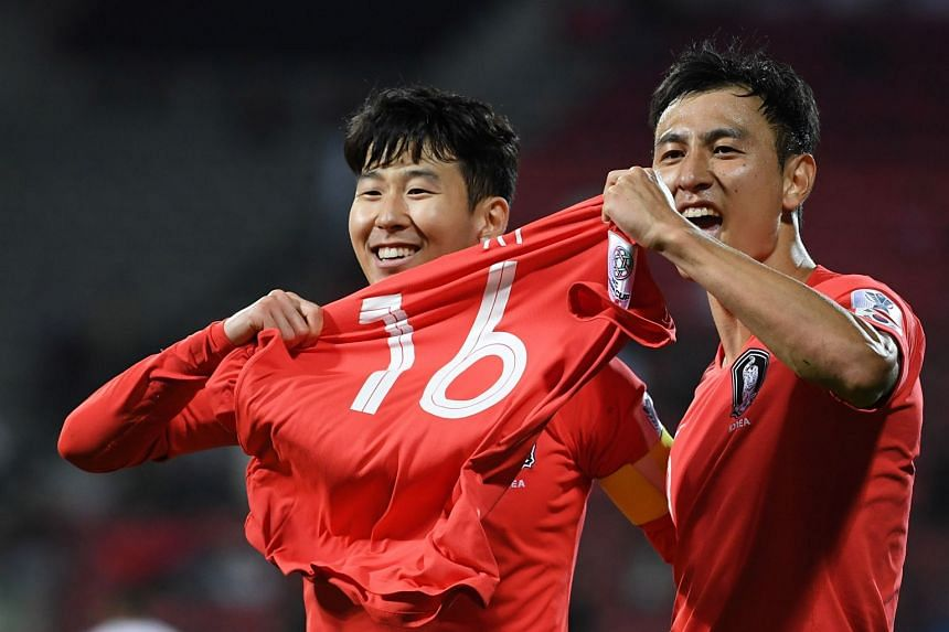Son Heung-Min (left) and Ji Dong-Won of South Korea celebrate the 2-1 goal.