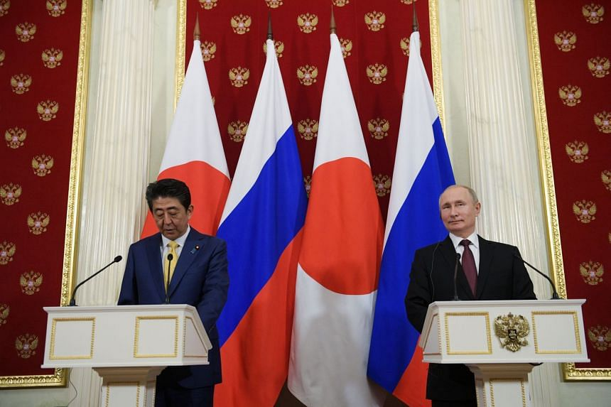 Russian President Vladimir Putin (right) and Japanese Prime Minister Shinzo Abe make a joint statement following their meeting at the Kremlin.