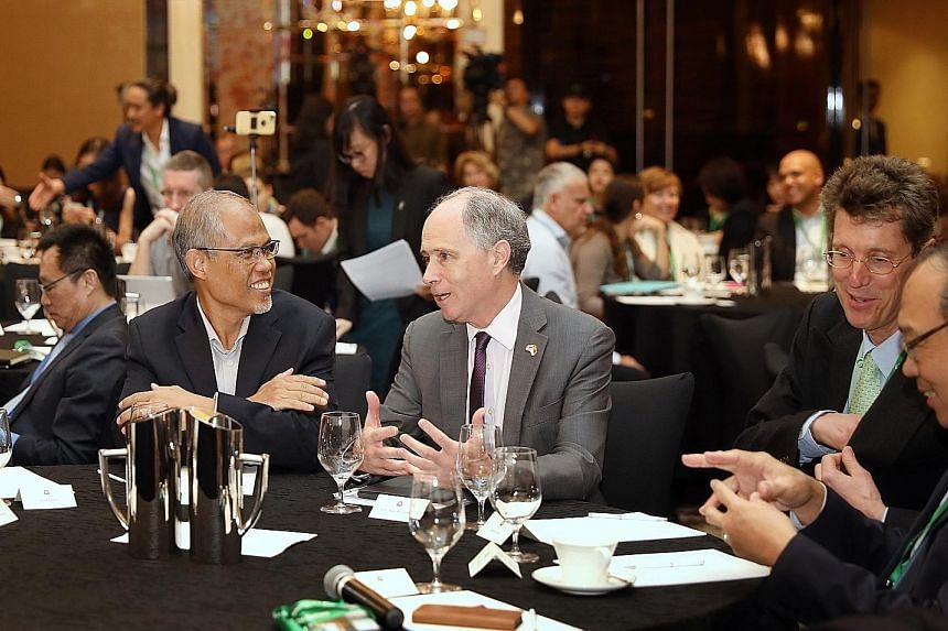 Minister for the Environment and Water Resources Masagos Zulkifli with British High Commissioner to Singapore Scott Wightman at the Unlocking Capital for Sustainability forum at St Regis hotel yesterday. Mr Masagos noted that sustainability efforts m