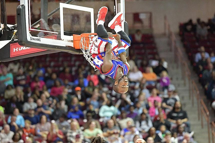 """Harlem Globetrotters' 1.35m guard Jahmani """"Hot Shot"""" Swanson after a dunk. The Globetrotters, who were last here in 2009, will play the Washington Generals, who are part of their travelling crew, on April 5."""
