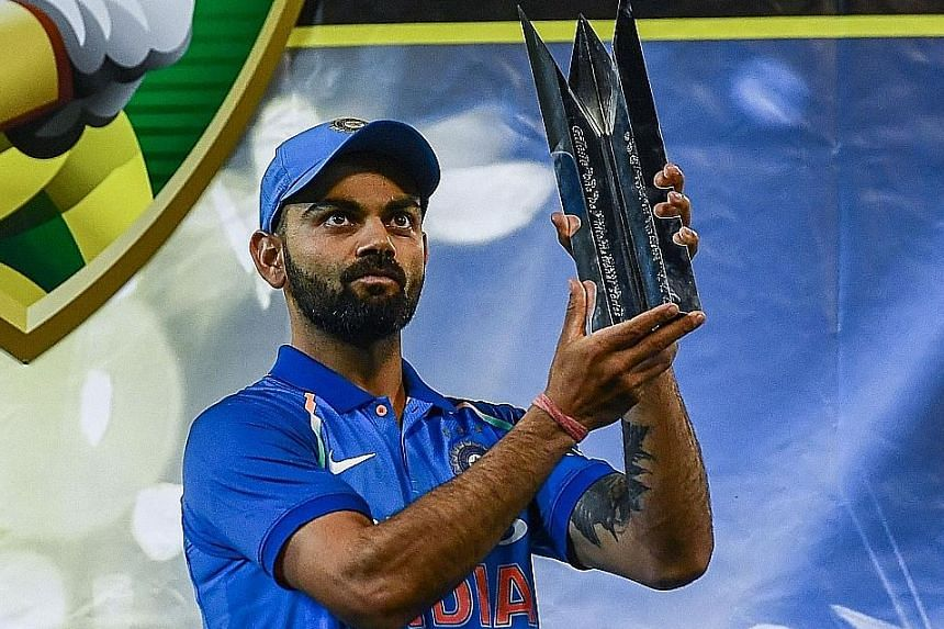 India captain Virat Kohli holding the one-day international series trophy after defeating Australia in Melbourne earlier this month.