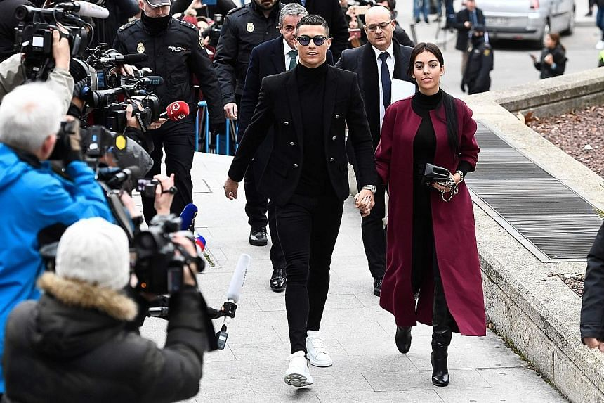 Cristiano Ronaldo arriving at the court hearing in Madrid yesterday along with his partner Georgina Rodriguez.