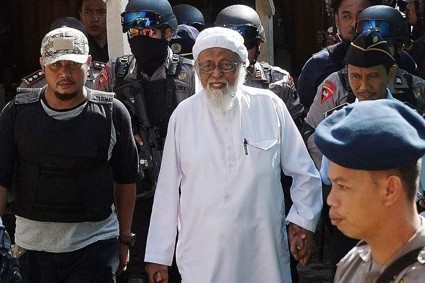 Radical Muslim cleric Abu Bakar Bashir being escorted by anti-terror police at an appeal trial in Central Java in 2016. The decision to release him had drawn strong criticism both domestically and internationally.