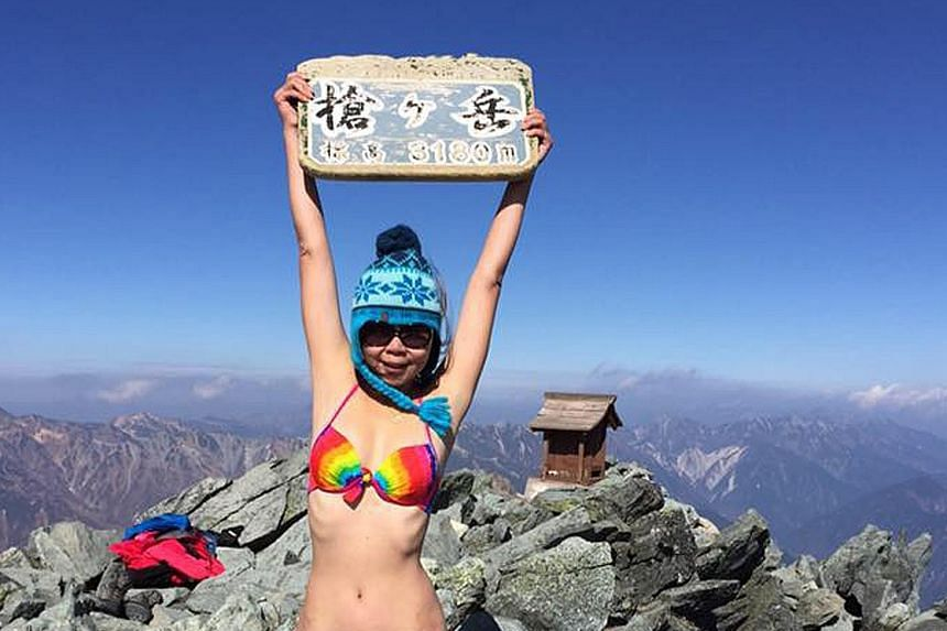 Social media star Gigi Wu (left), known for posting photos of herself in a bikini on mountaintops, used a satellite phone last Saturday to tell friends she had fallen down a ravine in Taiwan's Yushan National Park and badly injured herself. Rescue wo