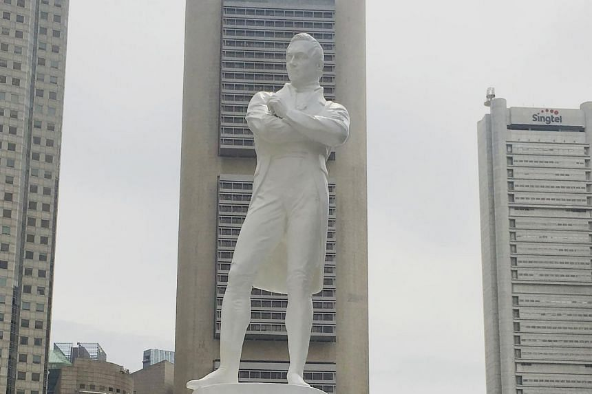 The statue of Sir Stamford Raffles along Boat Quay in Singapore.