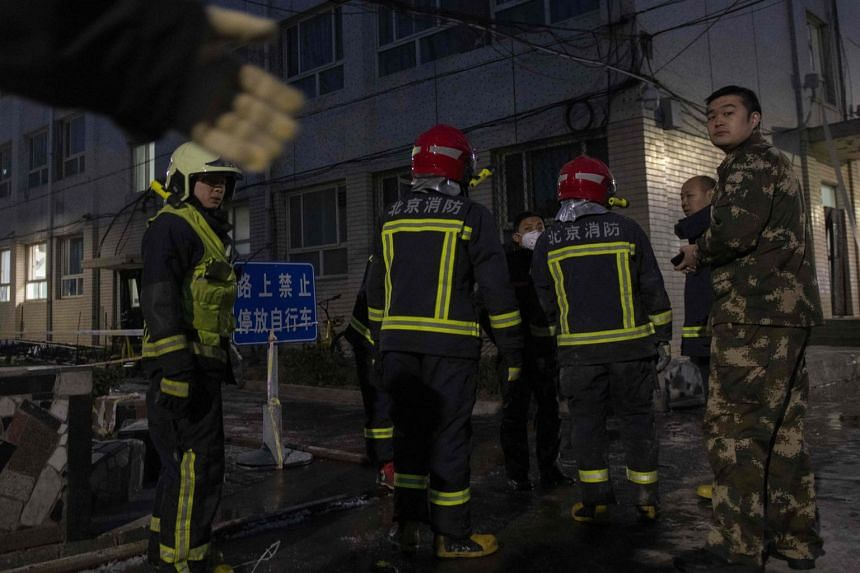 Firemen work at the site of an explosion at Beijing Jiaotong University in December 2018.