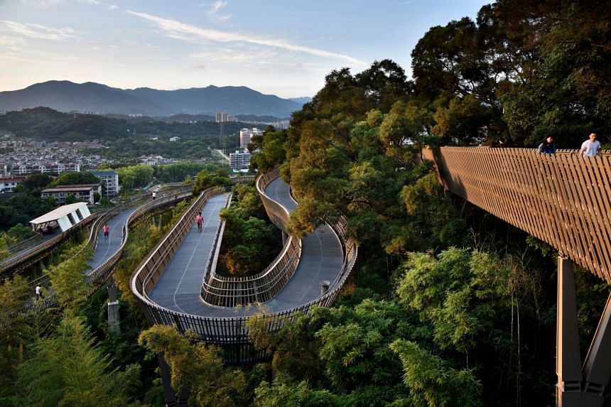 China Fuzhou Jin Niu Shan Trans-Urban Connector's modular walkway system consists of eight components which can adapt to the mountainous terrain to create a highly accessible pedestrian space. PHOTO: Zhou Yue Dong