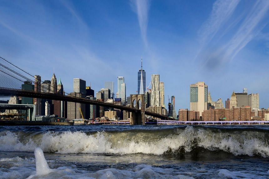 The skyline of New York City. About 172,000 US households have net worths of at least US$25 million.