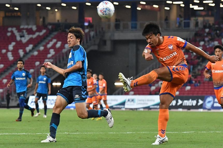 Albirex Niigata FC's Kenya Takahashi (right) clearing the ball away from Tampines Rovers FC's Ryutaro Megumi, during the Community Shield match at the National Stadium on March 31, 2018.