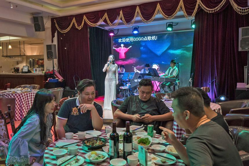 "Singers in elegant gowns perform renditions of Teresa Teng's signature ballads in the Teresa Teng Music-Themed Restaurant in Beijing, which also serves dishes inspired by her music. Teng's music was once banned in the mainland for being ""decadent"" an"