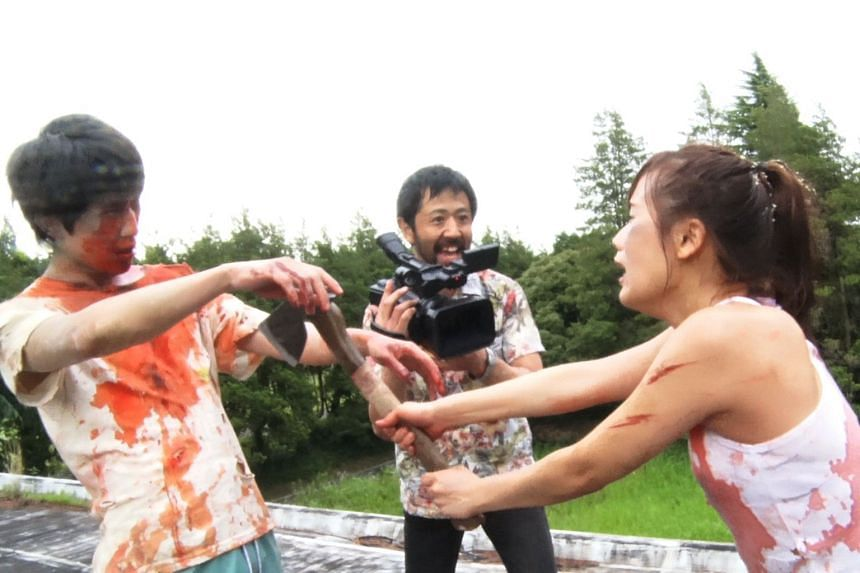 One Cut Of The Dead stars Takayuki Hamatsu (centre) as a director filming a zombie movie when a real zombie apocalypse occurs.
