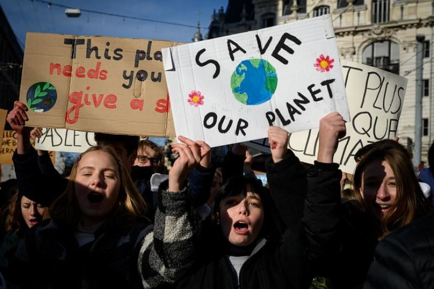 "Students show placard reading ""Save our planet"" in a protest against climate during a strike in Lausanne, Switzerland, on Jan 18, 2019."