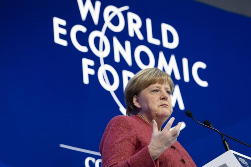 Angela Merkel speaks during a plenary session in the Congress Hall at the 49th annual meeting of the World Economic Forum, in Davos on Jan 23, 2019.