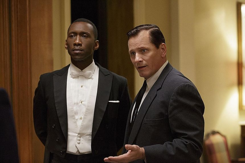 Green Book stars Mahershala Ali (left) as a gifted but aloof jazz pianist and Viggo Mortensen as his driver.