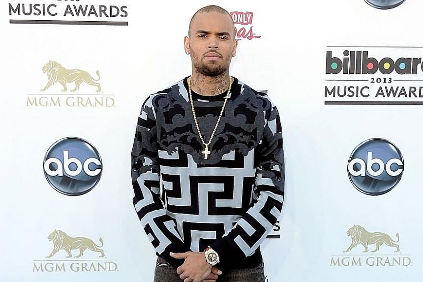 ARTISTS IN TROUBLE: Rapper Chris Brown (left) was detained on Monday in Paris after a woman filed a rape complaint. He has since been released. Singer R. Kelly (above), who has been accused of coercing women into having sex when they were underage, i