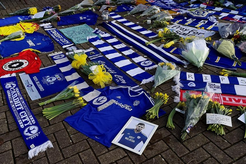 Emiliano Sala has yet to play in Cardiff City's colours, but Bluebirds fans have been leaving tributes, including jerseys and yellow daffodils outside the stadium for their record signing.