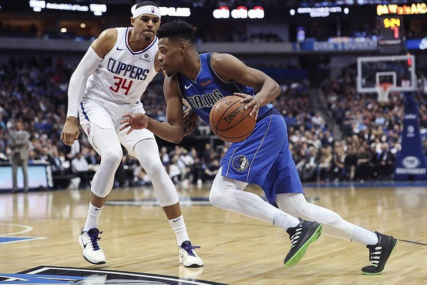 Dallas Mavericks guard Dennis Smith Jr driving to the basket past LA Clippers forward Tobias Harris at the American Airlines Centre. The Mavericks won 106-98 to improve to 21-26.