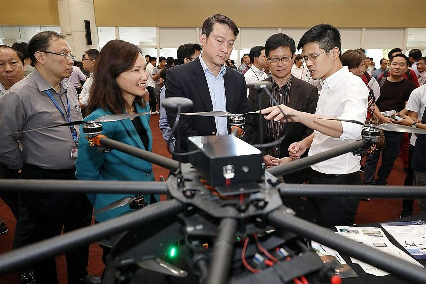 Garuda Robotics chief executive Mark Yong briefing Senior Minister of State for Transport and Health Lam Pin Min (centre), ITE CEO, Ms Low Khah Gek, and Science Centre Singapore CEO, Associate Professor Lim Tit Meng, at the inaugural Drone Technology