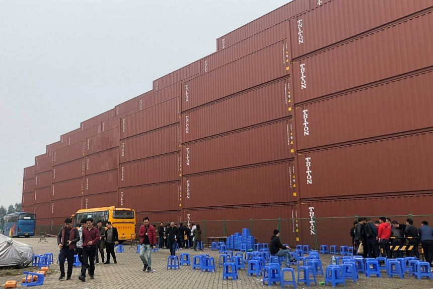 Workers seen outside at a Maersk container factory in Dongguan, China, on Jan 7, 2019.