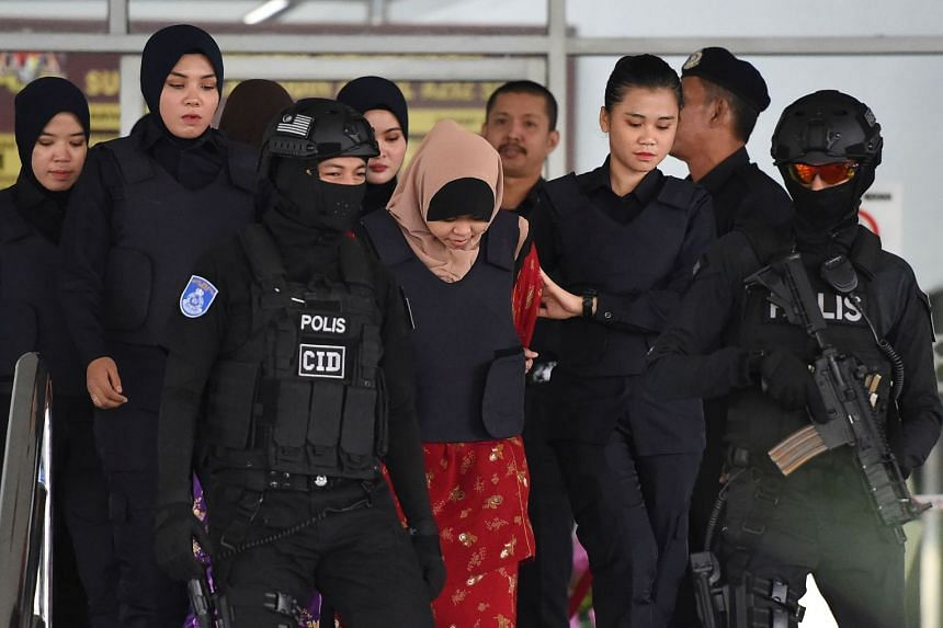 Indonesian national Siti Aisyah being escorted by Malaysian police after a special court session to rule on witness statements at the Shah Alam High Court, outside Kuala Lumpur, on Dec 14 for her alleged role in the assassination of Kim Jong Nam, the