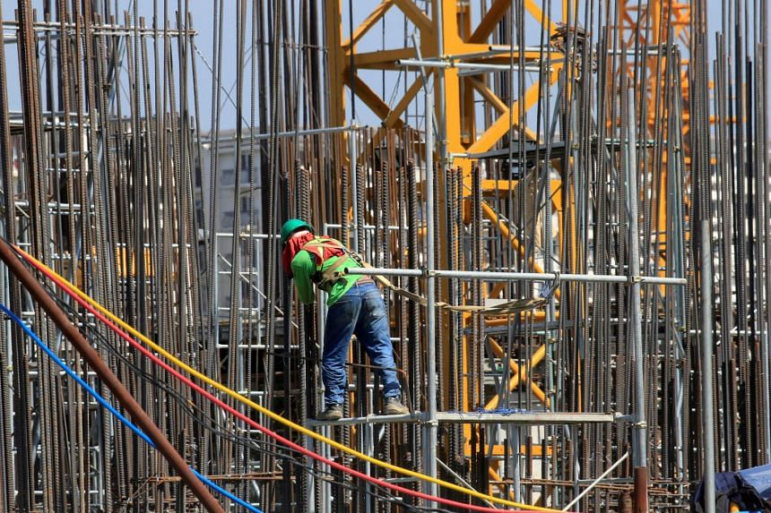 A worker installs steel rods at a construction site in Paranaque city, metro Manila, Philippines on May 29, 2018.