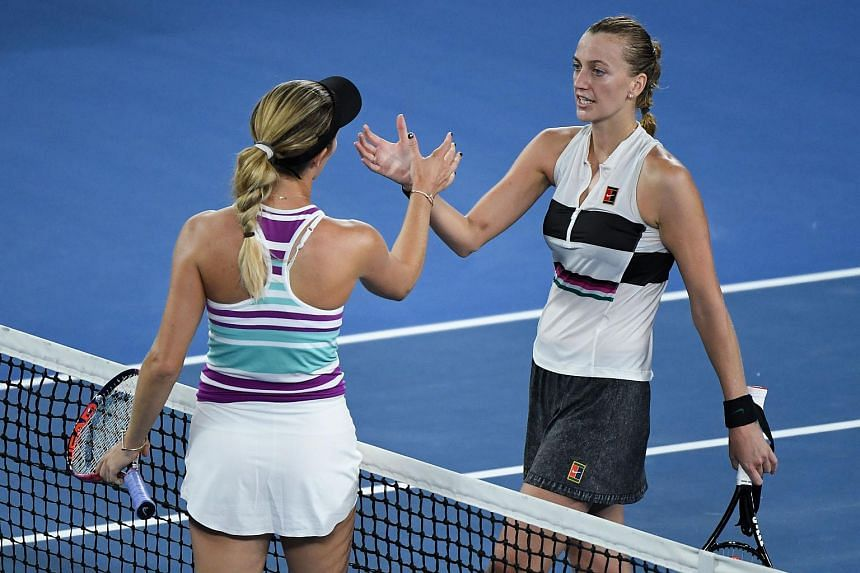 Petra Kvitova (right) shakes hands with Danielle Collins after winning their women's singles semi-final match at the Australian Open on Jan 24, 2019.