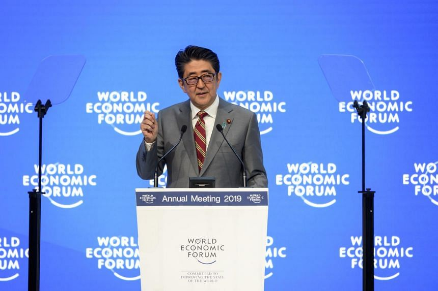 Prime Minister Shinzo Abe of Japan said his country would use its chairmanship of the Group of 20 nations this year to push forward a new international system for the oversight of how data is used.