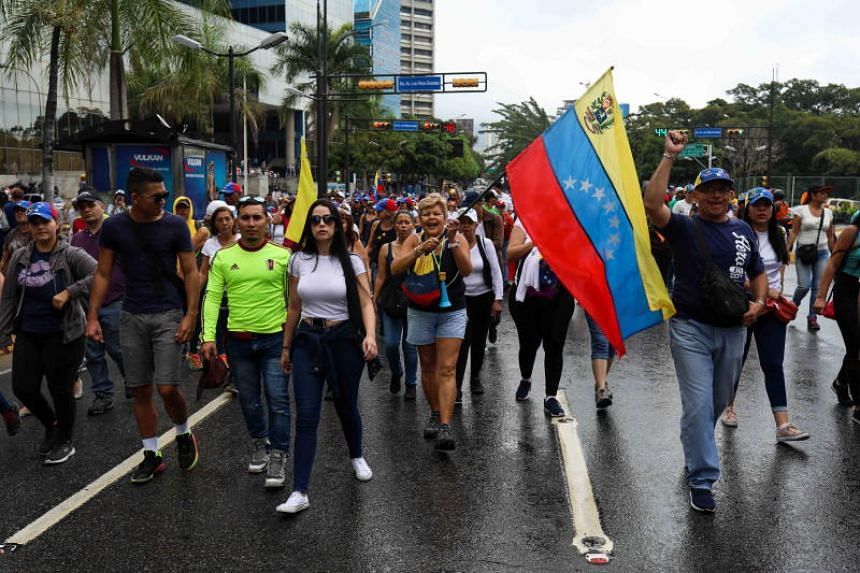 Protesters attend a rally to protest against the Venezuelan President Nicholas Maduro in Caracas, Venezuela, on Jan 23, 2019.
