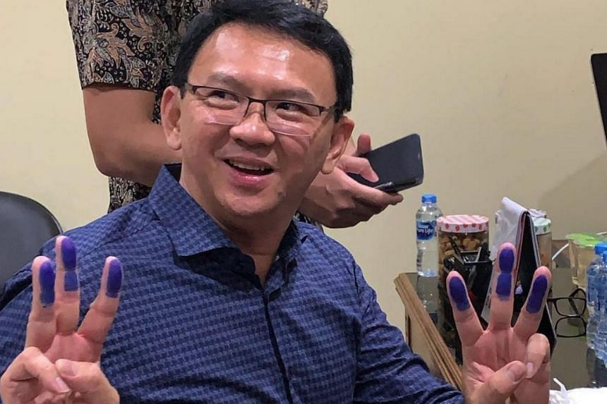 Former Jakarta governor Basuki Tjahaja Purnama smiles as he undergoes the administrative process before being released on Thursday.