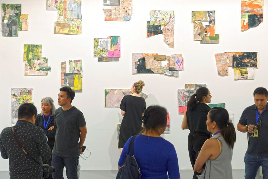 Visitors at the preview of the S.E.A. Focus art fair yesterday. Last week, organisers of Art Stage Singapore, another art fair, cancelled the event that was supposed to have run from tomorrow to Sunday. Since the cancellation, there has been a ground