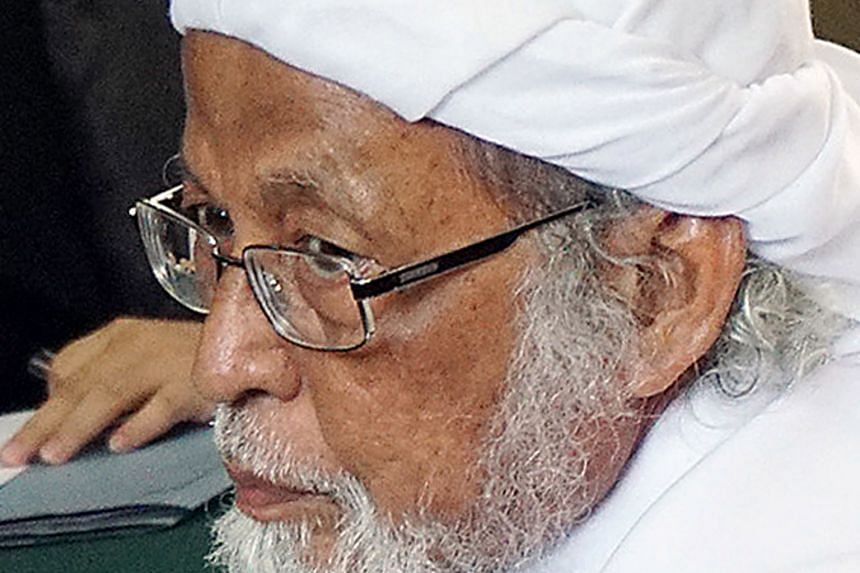 President Joko Widodo has ordered a review into the decision of the early release on medical grounds of jailed radical cleric (left) Abu Bakar Bashir, 80, the mastermind of the 2002 Bali bombings. The President had on Tuesday said Bashir would be rel