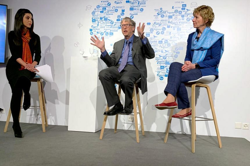 Billionaire philanthropist Bill Gates at an informal discussion in Davos on Jan 23, with Dr Sue Desmond-Hellmann, CEO of the Bill & Melinda Gates Foundation. The session was moderated by TV anchor Shereen Bhan (left).